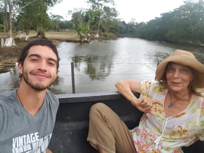 My dear friend Mary Loan and I in the back of a pickup crossing the Macal River in San Ignacio, Belize.